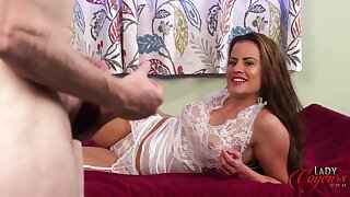 Clothed battle-axe Sarah Snow spreads her legs to tease a naked challenge