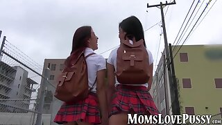 Two schoolgirls have sex with a hot mature lesbian babe