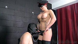 Female cop acts dominant with her male slave